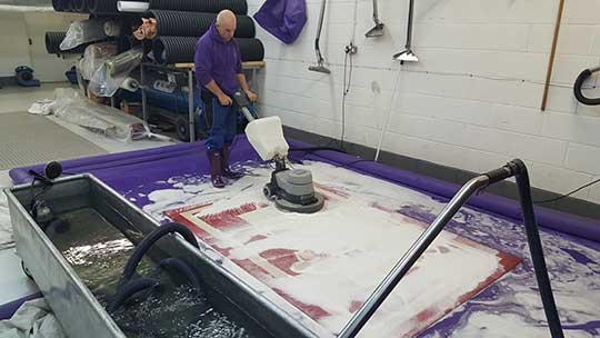 Rug Cleaning Cheshire washing a rug at Arcadia Rug Spa